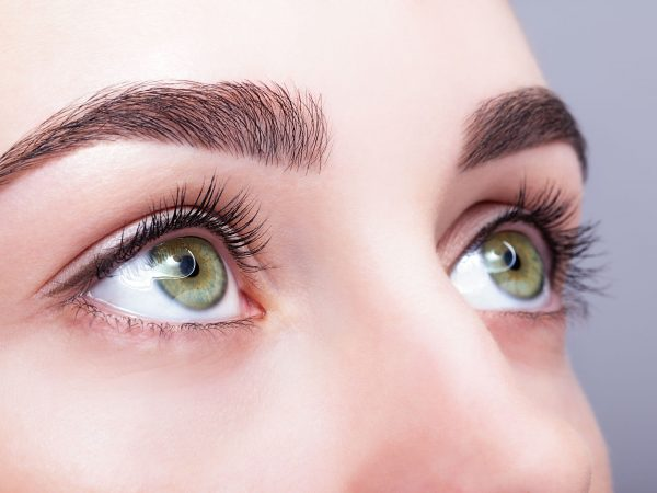 37028665 – closeup shot of female green pistachio colour eye  with day makeup